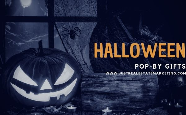 Scary pumpkin sitting in a window with Halloween Pop-By Gifts overlay. JustRealEstateMarketing.com