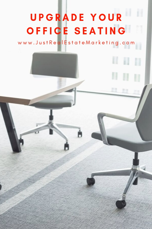 White office chairs around a light wooden office conference table, all contemporary in style.