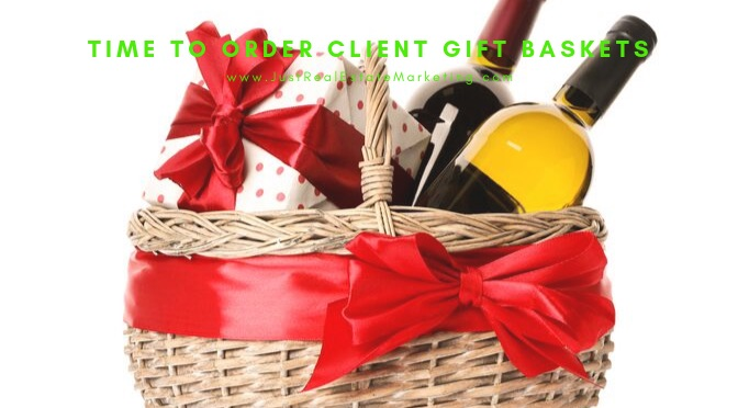 Gift basket with wine, small present and red ribbon